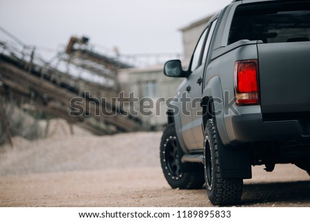 Pickup suv car at the gravel carrier. Back view of truck at the rural road #1189895833