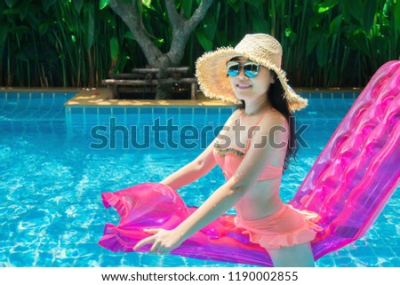 Women are relaxing at the poolside. woman relaxing in swimming pool spa. Cute girl is relaxing in the pool.Relax pool spa.Outdoor Swimming Pool.Relaxing day in summer.