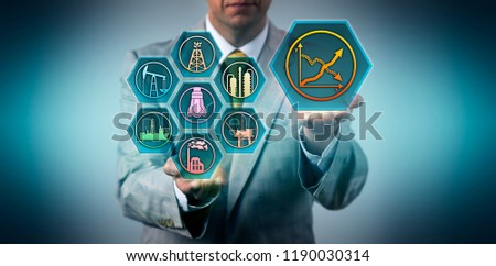 Businessman predicting break even point of his oil and gas industry investment. Business concept for ROI, energy efficiency, return on investment, fossil power resources, energy policy and strategy. #1190030314
