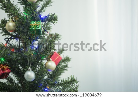 A Christmas tree and ornament #119004679