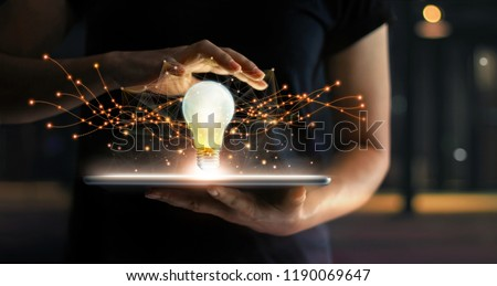 Abstract. Innovation. Hands holding tablet with light bulb future technologies and network connection on virtual interface background, innovative technology in science and communication concept   #1190069647