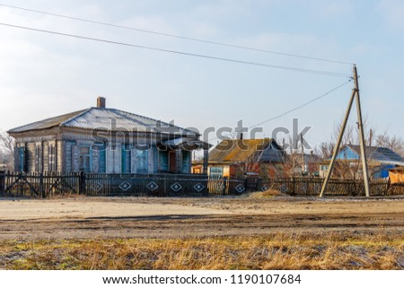 Mariinskaya stanitsa, Rostov-on-Don region / Russia - 02-14-2015. The street of the russian village with old abandoned wooden dwelling. #1190107684