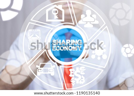 Man clicks a sharing economy text button on a virtual display. Sharing Economy Business Financial concept. #1190135140