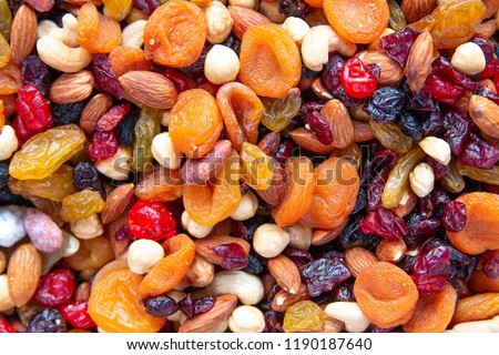 Dried fruits with nuts. Cashew, hazelnuts, peanuts, dried apricots, viburnum, raisins. #1190187640
