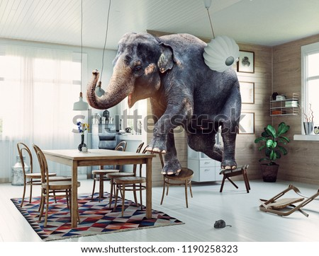 Frightened elephant runs from mouse to table. Photo and media mixed creative combination #1190258323
