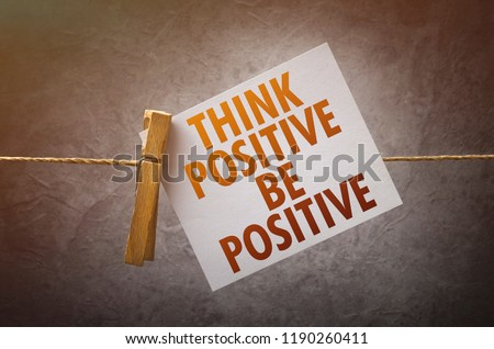 Think positive be positive paper note attach to rope with clothes pins #1190260411