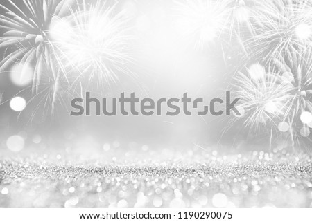 Silver and white Fireworks and bokeh in New Year eve and copy space. Abstract background holiday. #1190290075