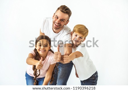 The father and kids thumbs up on the white background #1190396218