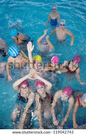 happy children kids group  at swimming pool class  learning to swim #119042743