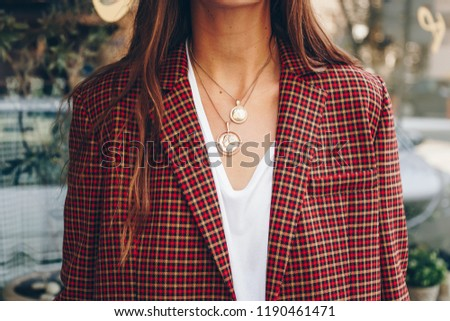 fashion blogger outfit details. fashionable woman check plaid blazer, white t shirt and chunky round coin chain necklace. detail of a perfect fall fashion 2018 outfit.  #1190461471