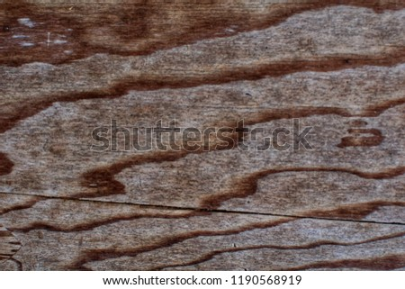 Watermark on texture of the old wooden cutting board background.