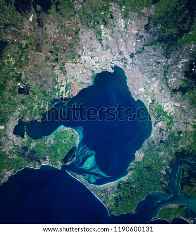 High resolution satellite image of Melbourne and Port Phillip bay, Victoria, Australia, from above, aerial view, natural background map, contains modified Copernicus Sentinel data [2018]