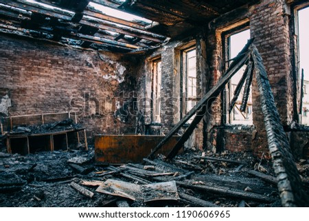 Burnt room interior with walls, furniture and floor in ash and coal, ruined building after fire, toned #1190606965