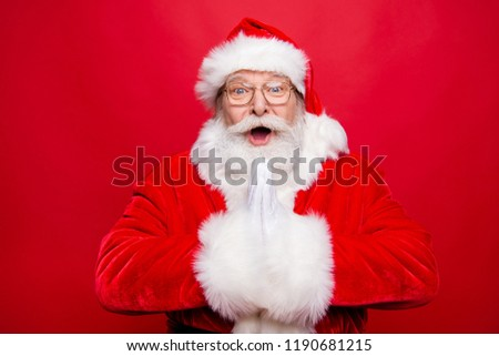 Reaction emotions concept. Impressed aged stylish Santa in spectacles open mouth staring eyes expressing face white beard clapped in hands have incredible news isolated on vivid red background #1190681215