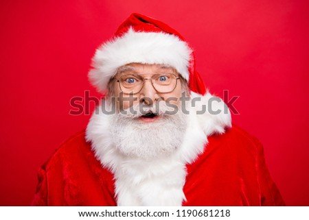 Reaction win winner victory concept. Stylish Santa in headwear spectacles with white beard open mouth staring eyes expressing face have idea or news isolated on shine red background #1190681218