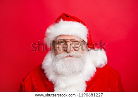 Holly jolly is coming! Close up portrait of stylish friendly calm Santa face look at camera stand isolated on vivid red background #1190681227