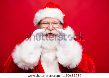 Holly jolly x mas coming! Time to share message sale discount novelty information with you. Aged Santa with open mouth hold palm hand near face saying or make noisy speak isolated on red background #1190681284