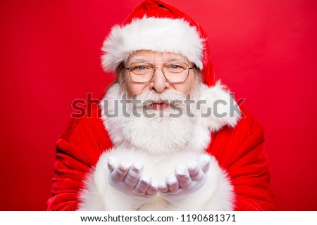Holly jolly x mas is coming! Close up portrait of stylish aged handsome kind cheerful positive Santa hold palms hand near face pouted lips send noel kiss isolated on vivid red background #1190681371