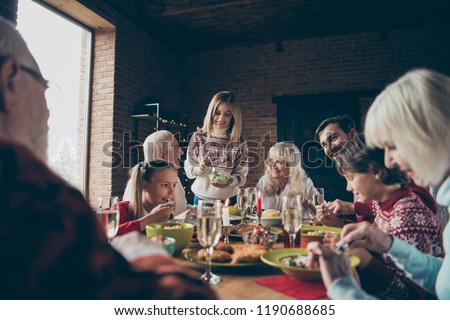 Noel evening, night family gathering, meeting. Cheerful grey-haired grandparents, grandchildren, brother, sister, relatives sitting at table, house fun joy party, feast, eating tasty yummy food #1190688685