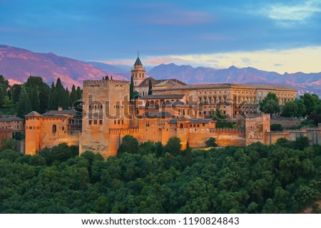 Granada, Spain. Aerial view of Alhambra Palace in Granada, Spain with Sierra Nevada mountains at the background. Sunset sky  #1190824843