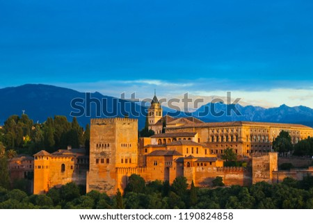 Granada, Spain. Aerial view of Alhambra Palace in Granada, Spain with Sierra Nevada mountains at the background. Sunset sky  #1190824858