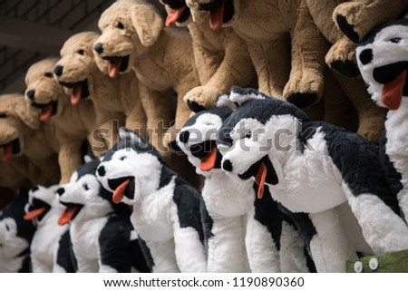 Cuddly soft toys of husky dogs from the kids shop for sale in a gift shop #1190890360