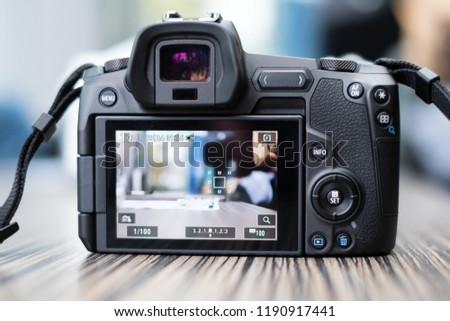 COLOGNE, SEPTEMBER 2018 - Recently launched Canon EOS-R  camera - first mirrorless full frame camera from Canon - is displayed for editorial purposes. Shallow focus effect. #1190917441