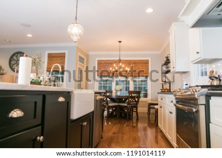 Spacious Modern Kitchen with Dark and White Cabinets Wood Floors Marble Island  #1191014119