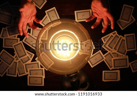 A sorcerer's table with a fortune-teller ball and mask #1191016933