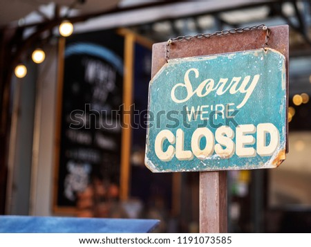 sorry we are closed sign hanging outside a restaurant, store, office or other #1191073585