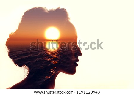 Psychology concept. Sunrise and woman silhouette. #1191120943