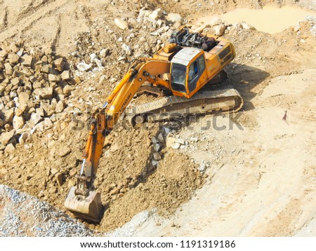 Kuala  Lumpur, Malaysia - August 12,2018 : Close up  of industrial excavator working on construction site. Selective focus and crop fragment #1191319186