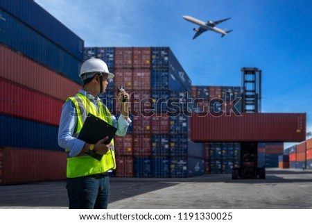 Foreman control loading Containers box to truck for Logistic Import Export Background, Business logistic concept, import and export concept #1191330025