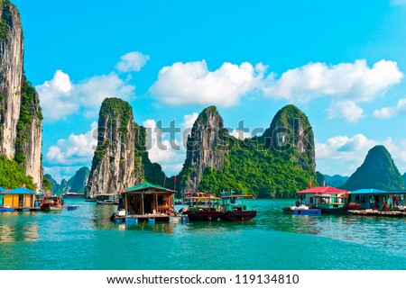 Floating village and rock islands in Halong Bay, Vietnam, Southeast Asia Royalty-Free Stock Photo #119134810