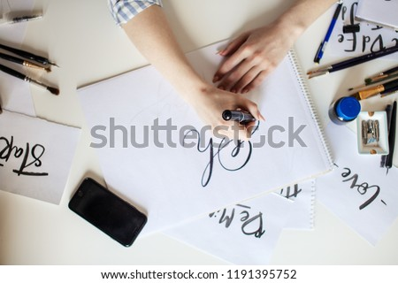 High angle view of Woman hands writing Oh words on white paper #1191395752