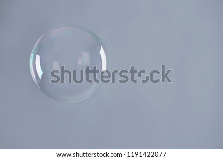 Beautiful translucent soap bubble on grey background. Space for text #1191422077