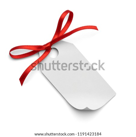 close up of a note card with red ribbon bow on white background #1191423184