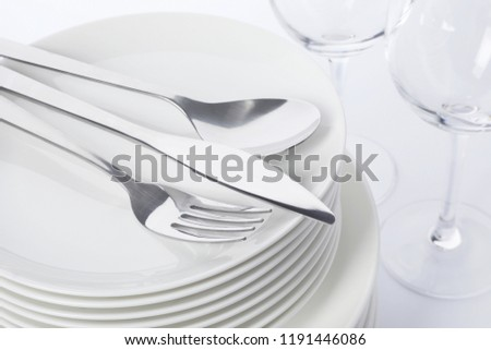 Set of clean tableware on white background, closeup. Washing dishes #1191446086