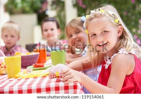 Group Of Children Enjoying Outdoor Tea Party #119154061