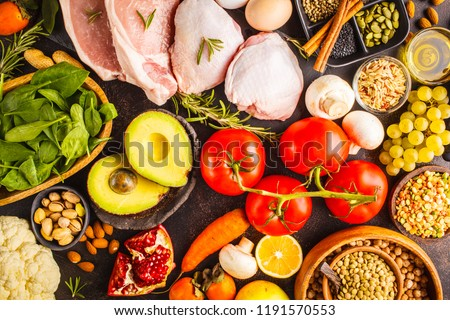 Balanced diet food background. Healthy ingredients: fruits, vegetables, meat, cereals and nuts on a dark background, top view. #1191570553