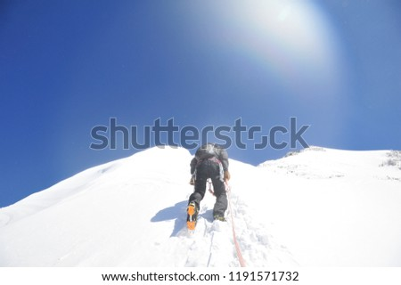 climbing in the winter mountain #1191571732
