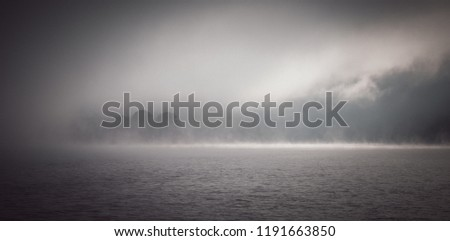 The mist in the lake in the morning. (vintage tone) #1191663850