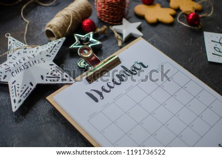 2018 year end review, date planning, appointment, deadline or holiday concept on wooden table next to black clean calendar on month of December. Royalty-Free Stock Photo #1191736522
