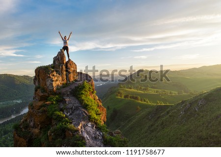 Woman on top mountain in Altai, sunset light, beauty summer landcape Royalty-Free Stock Photo #1191758677