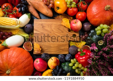 Healthy food background with autumnal vegetables and fruits. Autumn fruits vegetables and leaves set. Thanksgiving day concept. Top view with copy space #1191884950