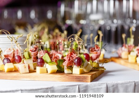 Light snacks in a plate on a buffet table. Assorted mini canapes, delicacies and snacks, restaurant food at event. A gala reception. Decorated delicious table for a party goodies. #1191948109
