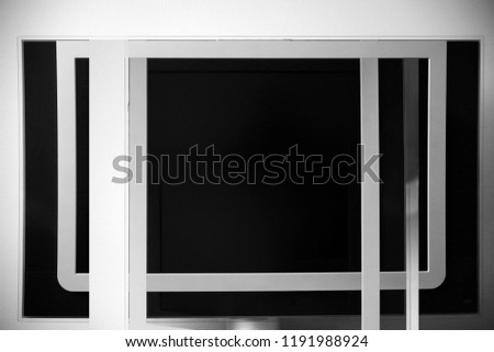 Multiple exposure photo of black panels in white frames. Abstract black and white geometric background on the subject of industry or technology. #1191988924