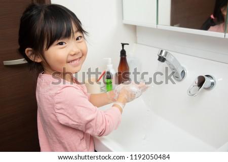 little asian girl washing hands #1192050484