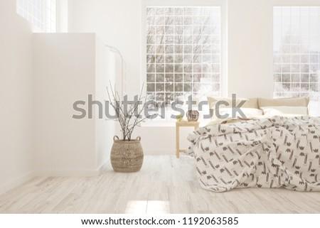 White bedroom with winter landscape in window. Scandinavian interior design. 3D illustration #1192063585
