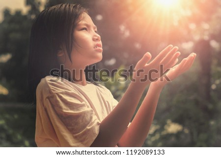 children hands open palm up worship.  Bless God. Pray of hope #1192089133